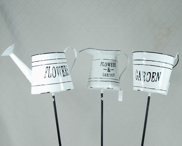 White enamel pot yard stakes
